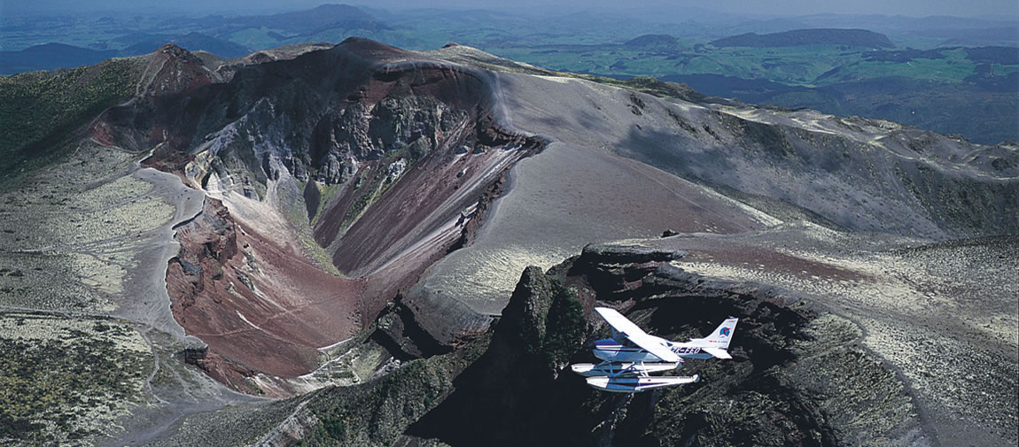Floatplane flying over volcano