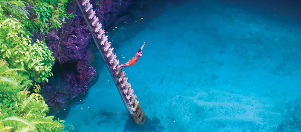 Man diving into the sea in Samoa