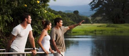 a man standing next to a river