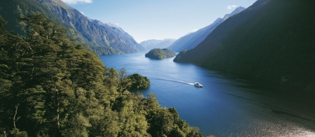 a body of water with Doubtful Sound in the background