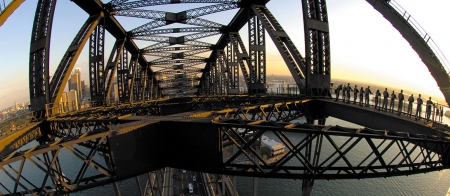 a train crossing a bridge over water
