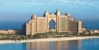 a large body of water with Atlantis, The Palm in the background