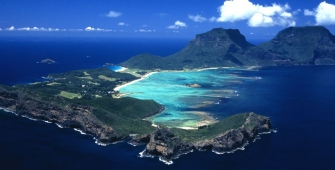 a body of water with Lord Howe Island in the background