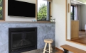a fire place sitting in a living room with a television and a fireplace