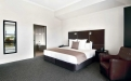 a bedroom with a large bed in a hotel room