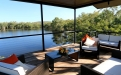 a view of a living room with a body of water