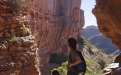a person standing in front of a canyon