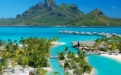a large body of water with Bora Bora in the background