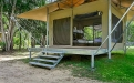 a couple of lawn chairs sitting on top of Farnsworth House