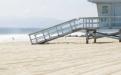 a bench on a sandy beach