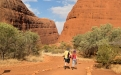 a group of people walking in front of a canyon