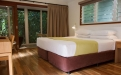 a hotel room with a wood floor