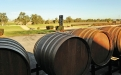 a train is parked on the side of a barrel