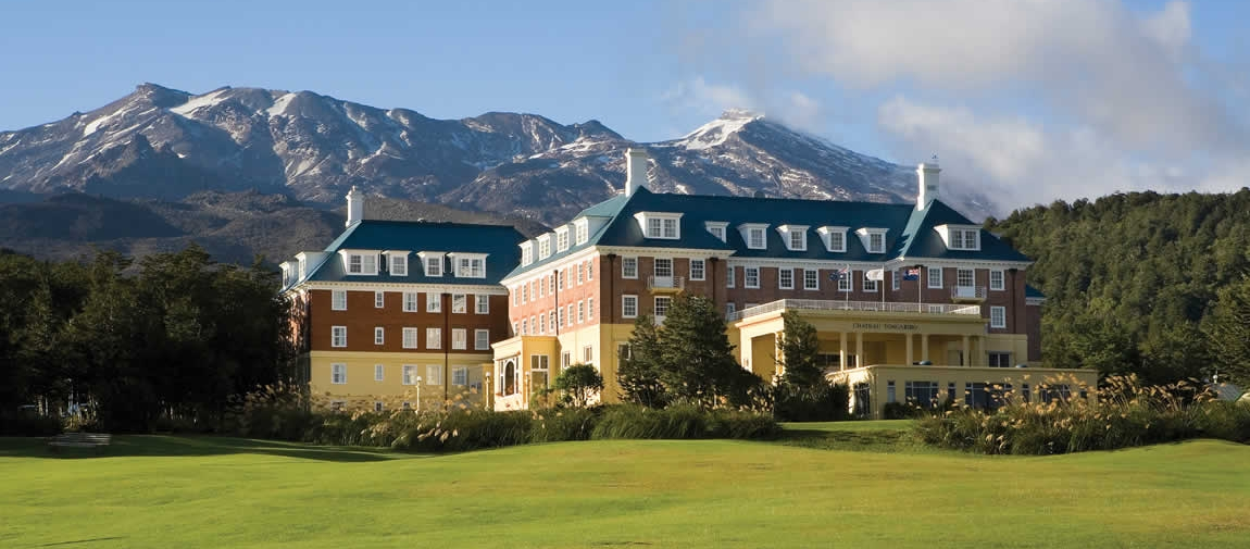 a large building with a mountain in the background