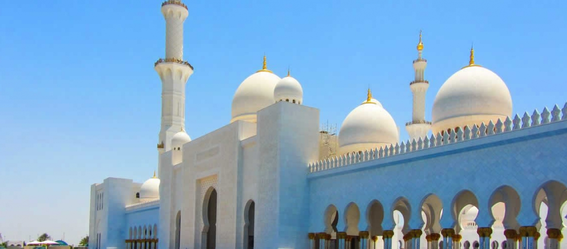 a group of people standing in front of Sheikh Zayed Mosque