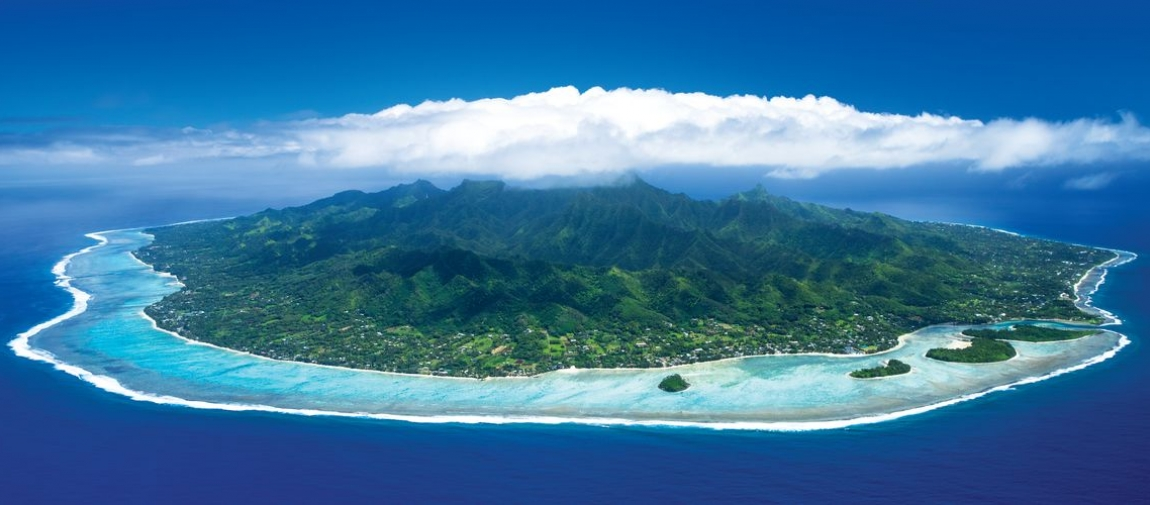 an island in the middle of a body of water with Rarotonga in the background