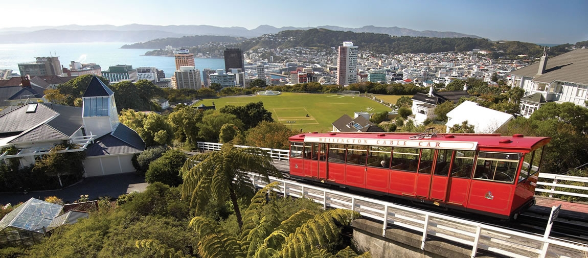 a passenger bus that is parked on the side of Wellington Cable Car