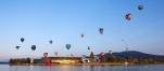a group of people flying kites in the air